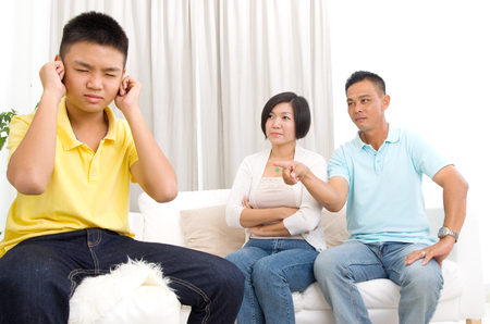 disobedience: people, misbehavior, family and relations concept - upset or feeling guilty boy and parents at home