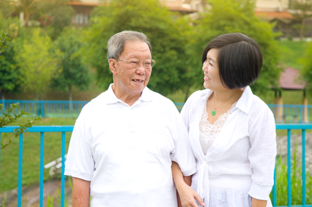 adult 80s: Senior man and daughter. Happy father talking with her daughter.