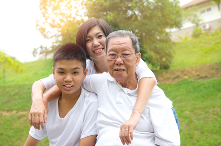 3 generation: Portrait Of Multi-Generation Chinese Family Relaxing at outdoor Park