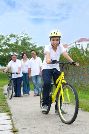 three generation: Asian three generation Family On Cycle Ride In Countryside