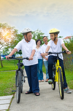 three generation: Asian  three generation Family On Cycle Ride In Countryside Stock Photo