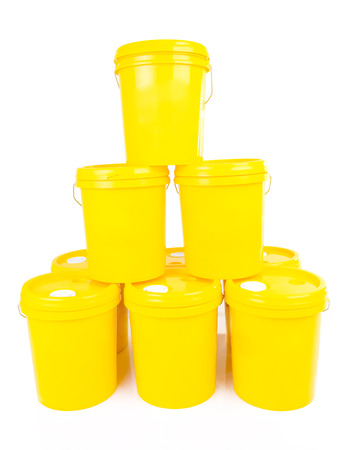 lubricant: Yellow plastic bucket with yelllow lid. Product Packaging for lubricant, oil.Isolated over white background. Stock Photo