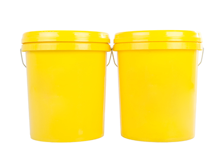 lubricant: Yellow plastic bucket with yelllow lid. Product Packaging for lubricant, oil. Isolated over white background.