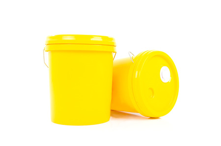 yelllow: Yellow plastic bucket with yelllow lid. Product Packaging for lubricant, oil.Isolated over white background. Stock Photo