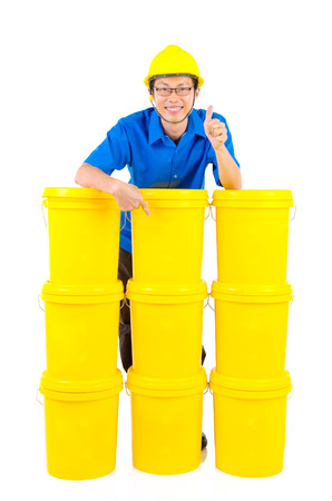 distributor: Lubricant oils and greases distributor with suit hardhat showing thumb-up, isolated on white background.