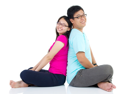 Young happy couple sitting together