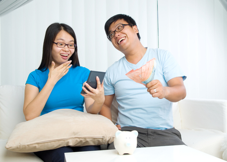 calculator chinese: husband and wife with family finance concept
