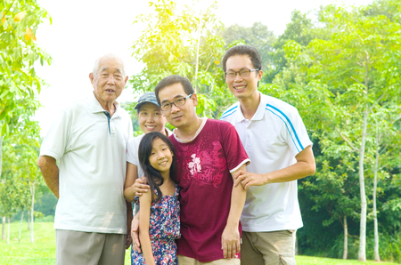 three generation: Portrait Of three Generation Chinese Family Relaxing at outdoor Park