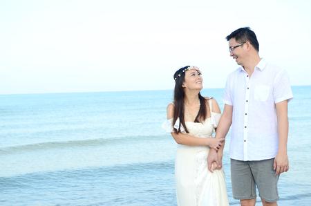 asian bride: Asian bride and groom on a tropical beach. Wedding and honeymoon concept.