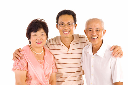 Indoor portrait of beautiful asian family over white background