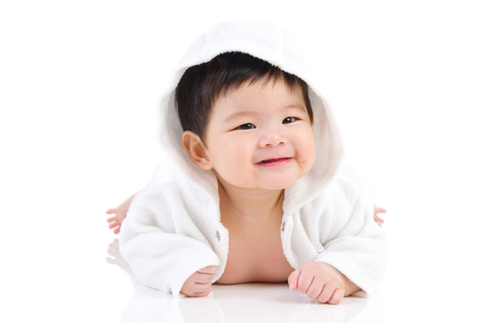 beautiful asian baby girl crawling on the floor