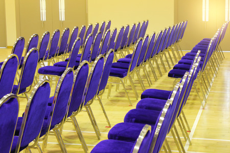 Conference room with chairs detail and yellow floor. Horizontal. Stock Photo