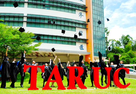 Setapak, Kuala Lumpur, Malaysia. August 27, 2017:Beautiful young graduates with diplomas toss their mortar boards into the air in front of Tunku Abdul Rahman Universiti College (TARUC).TARUC  is a leading public university in Malaysia.
