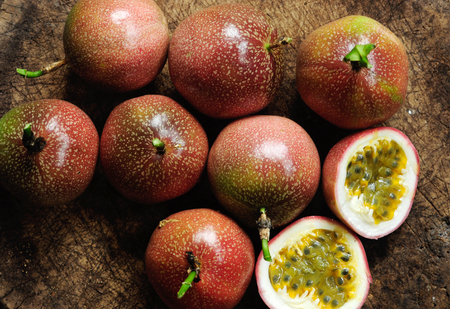 Passion fruit on old wooden table. Stock Photo - 87995041