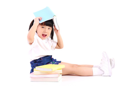 Asian girl sitting on the floor and reading book