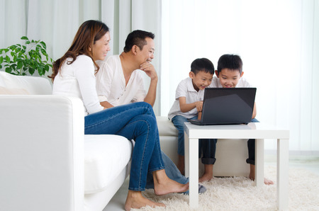 Asian family using laptop Stock Photo
