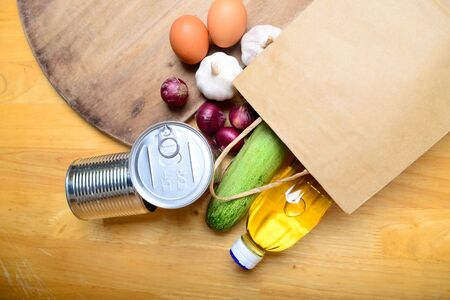 Food supplies crisis food stock for coronavirus quarantine isolation period on wooden background. Food delivery, Donation. top view. Stock Photo