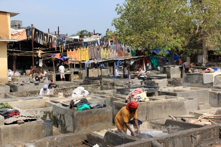dhobi ghat: Mumbai, India - October 27, 2011  Dhobi Ghat is a well known open air laundromat in Mumbai, India  The washers work in the open to wash the clothes from Mumbai