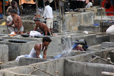 Mumbai, India - October 27, 2011  Dhobi Ghat is a well known open air laundromat in Mumbai, India  The washers work in the open to wash the clothes from Mumbai