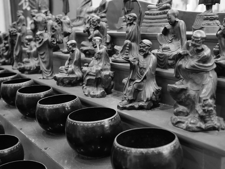 limosna: The monks alms bowl process in black and white tone