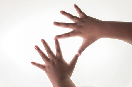 The right and left hand of a boy. Spread both fingers On a white backdrop