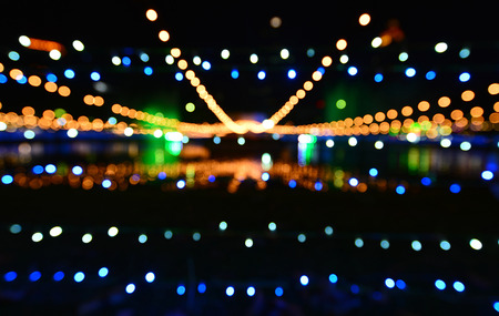 The sparkling theme of bokeh lighting in the form of a celebration in the image of the abstract background.
