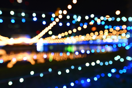 A sparkling pattern of bokeh lighting featuring the celebration of the abstract background.