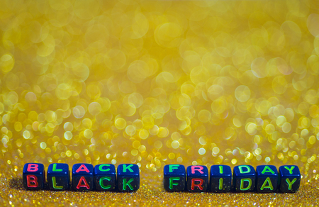 Black Friday, with free space and bokeh background light golden tone.