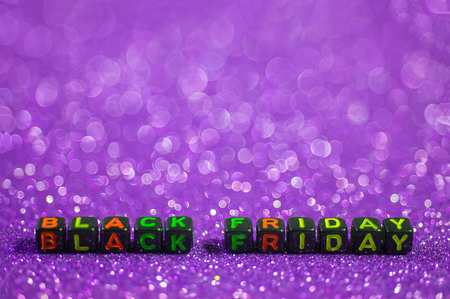Black Friday, with empty space and bokeh background sparkling purple. 版權商用圖片
