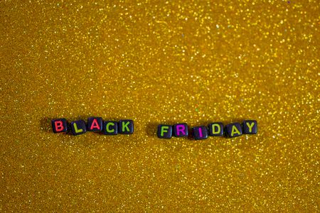 Black Friday, with sparkling background, bokeh shimmer, golden yellow tone.