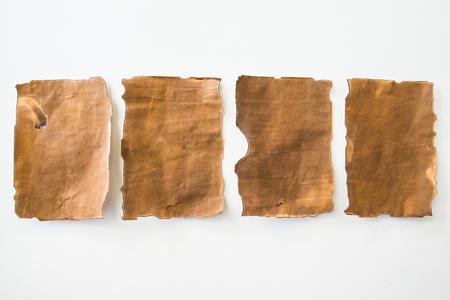 Old blank paper laid lined on a white background. Reklamní fotografie