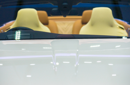 Blurred images .Front view of luxury car.