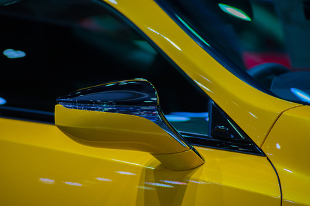 Side mirror, elegant and stylish yellow car. Stock Photo