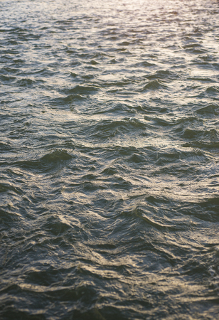 Surface texture of water with wave in the evening. Reklamní fotografie