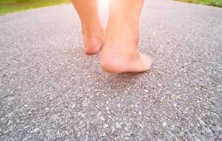 Walking foot on the asphalt.