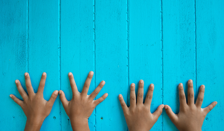 Childrens finger band lined up on a blue background. Stock Photo