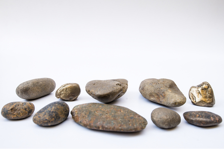 Balance the concept of different stone placement together on a white background.