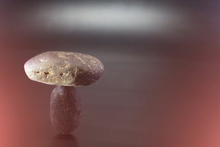 Balance the boulders concept together on a colorful background.