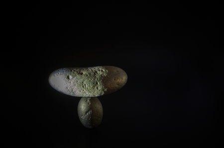 The concept of balance, stones, shapes and textures together with the natural balance on a black background.
