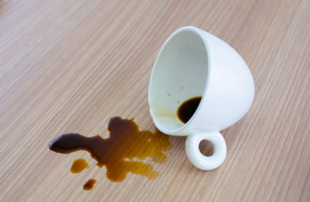 Spilled coffee cup stain on wooden floor