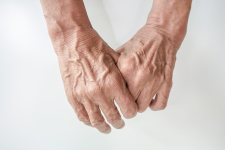 Hand and finger man is rough skin and wrinkles. Gesture on a white background with space.