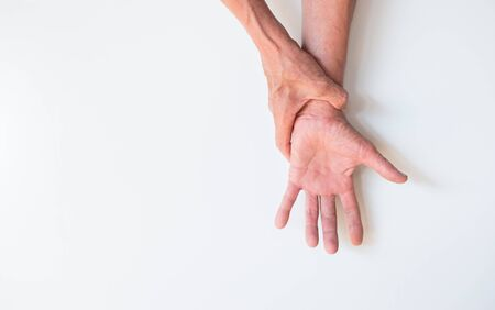 Two hands that are holding together on a white background with empty space