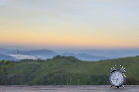 Alarm clock with natural scenery in the morning