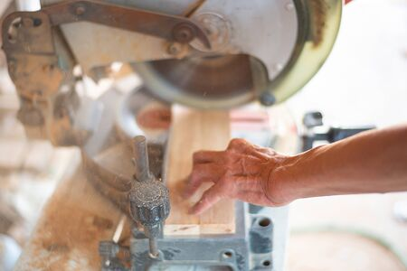 Hands that are working with dangerous machinery Banco de Imagens
