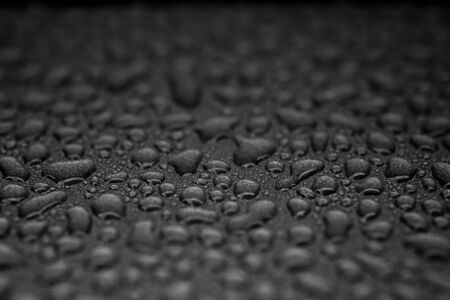 Many abstract liquid droplets on a black background