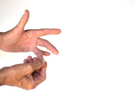 The muscles and joints of the fingers of the elderly men with inflammation