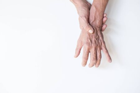Hands and fingers of elderly men with rheumatoid and musculoskeletal symptoms on the White Blackground Imagens