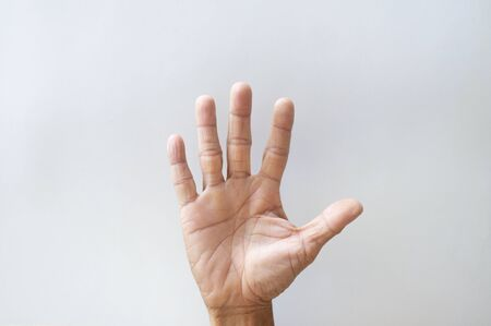 Palms and fingers of the elderly showing gestures on a white background