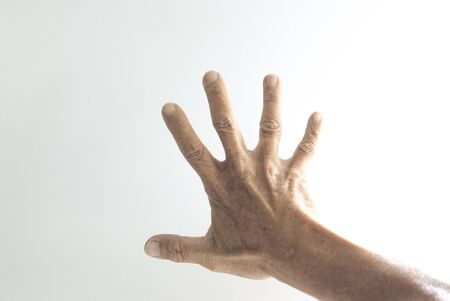 Palms and fingers of the elderly showing gestures on a white background Foto de archivo