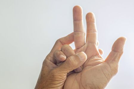 The fingers of the elderly showing signs of abnormal illness